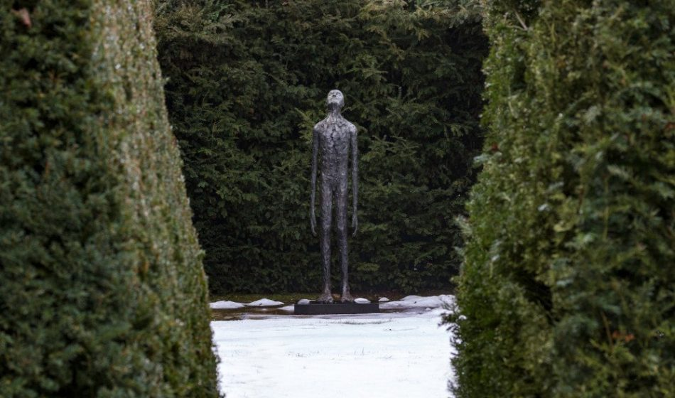 Manor House Hampshire - Bronze Sculpture of a Person in Winter